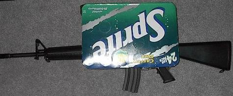 6ad3aec80f1 Still thirsty for justice? Try this badass M16A2 disguised as a 24-pack of  soda. The box has two finely crafted holes on each side to allow for any  kind of ...